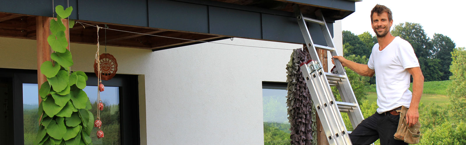 Spengler auf Leiter